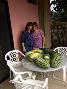 Maria & me with wild watermelons picked from neighbor's yard