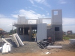 First story with concrete and second story going up