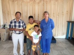 Duver, his boys and Lourdes in our little church building