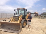 Jordan and Nate posing with the backhoe