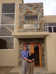 My part-time neighbors, Cliff & Linda, in front of their lovely home.