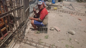 Leonardo working hard to tie the rebar supports for his new house